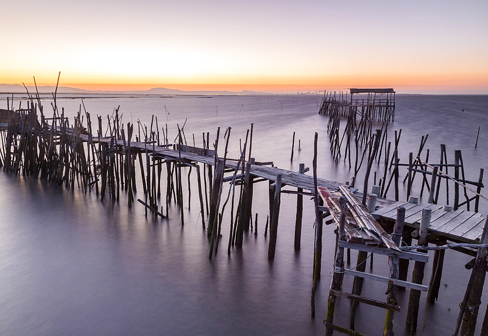 Sunset at Palafito Pier of Carrasqueira, Natural Reserve of Sado River, Alcacer do Sal, Setubal, Portugal, Europe