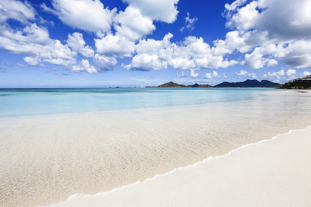 Blue sky frames the white sand and the turquoise Caribbean sea, Ffryes Beach, Antigua, Antigua and Barbuda, Leeward Islands, West Indies, Caribbean, Central America