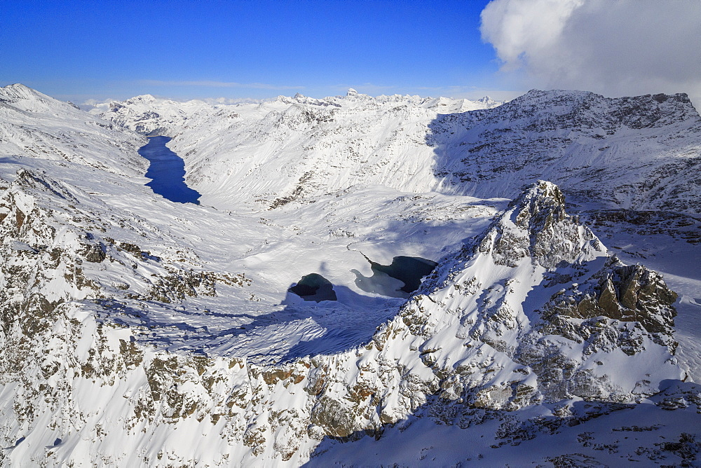 Aerial view of snowy Peak Peloso surrounded by Lago di Lei, Val di Lei Chiavenna, Spluga Valley, Valtellina, Lombardy, Italy, Europe