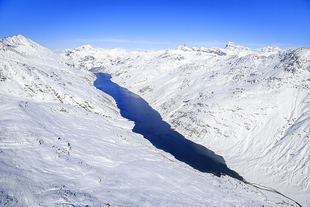 Aerial view of the alpine Lago di Lei surrounded by snow, Val di Lei, Chiavenna, Spluga Valley, Valtellina, Lombardy, Italy, Europe