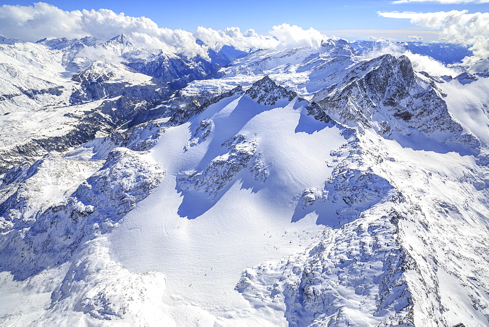 Aerial view of Peak Ferra covered with snow, Spluga Valley, Chiavenna, Valtellina, Lombardy, Italy, Europe