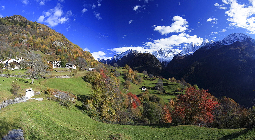 Panorama of the village of Soglio surrounded by colorful woods, Bregaglia Valley, Canton of Graubunden, Switzerland, Europe