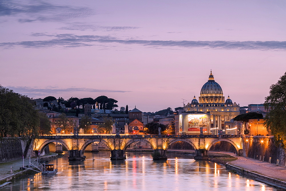 Dusk lights on Tiber River with bridge Umberto I and Basilica di San Pietro in the background, Rome, Lazio, Italy, Europe