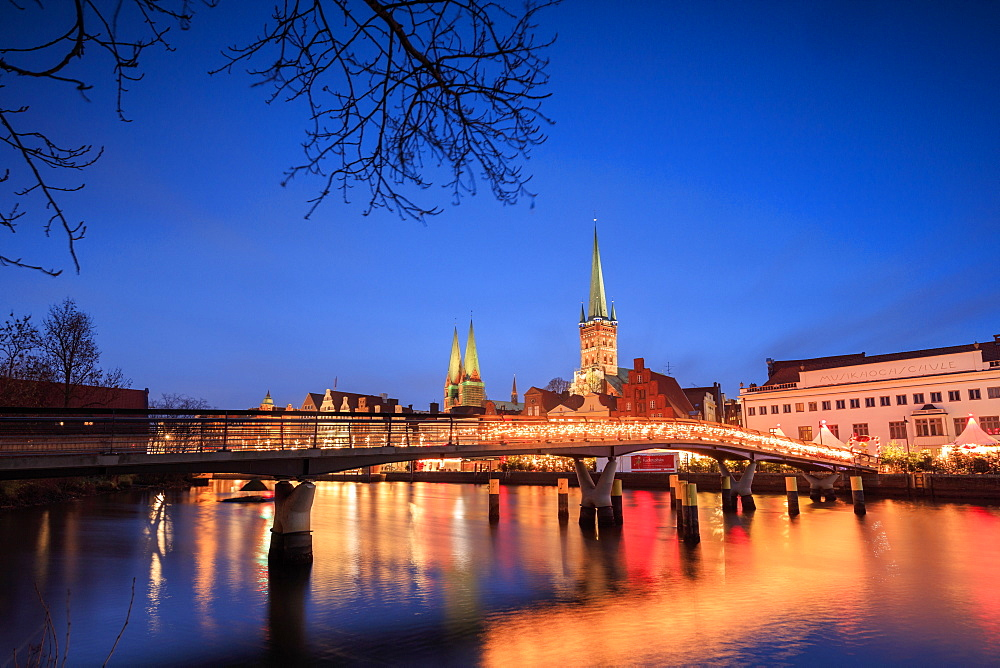 The lights of dusk on typical bridge and the cathedral reflected in River Trave, Lubeck, Schleswig Holstein, Germany, Europe - 1179-1215