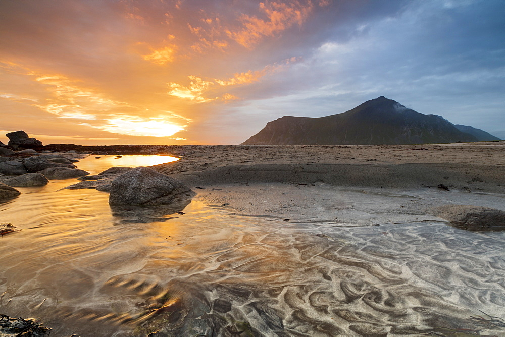 The midnight sun reflected on the sandy beach of Skagsanden, Ramberg, Nordland county, Lofoten Islands, Arctic, Northern Norway, Scandinavia, Europe