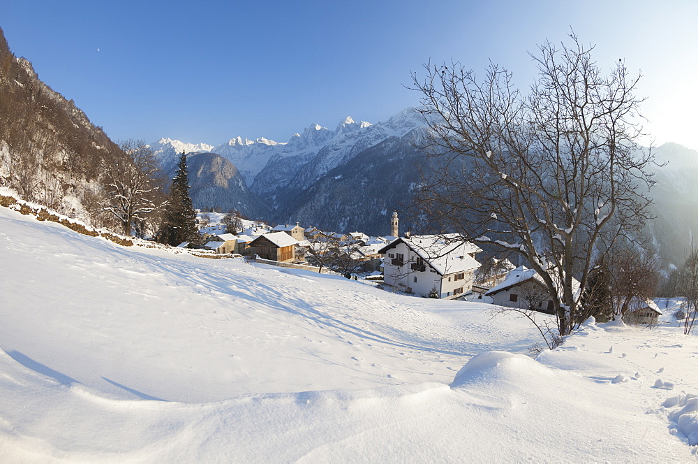 Sunset on the snowy village of Soglio, Maloja District, Bregaglia Valley, Engadine, Canton of Graubunden, Switzerland, Europe