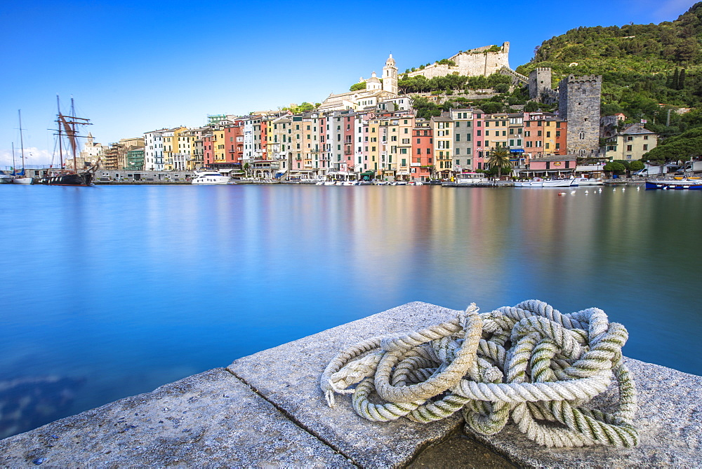 View from the pier of blue sea which frames the typical colored houses of Portovenere La Spezia province Liguria Italy Europe