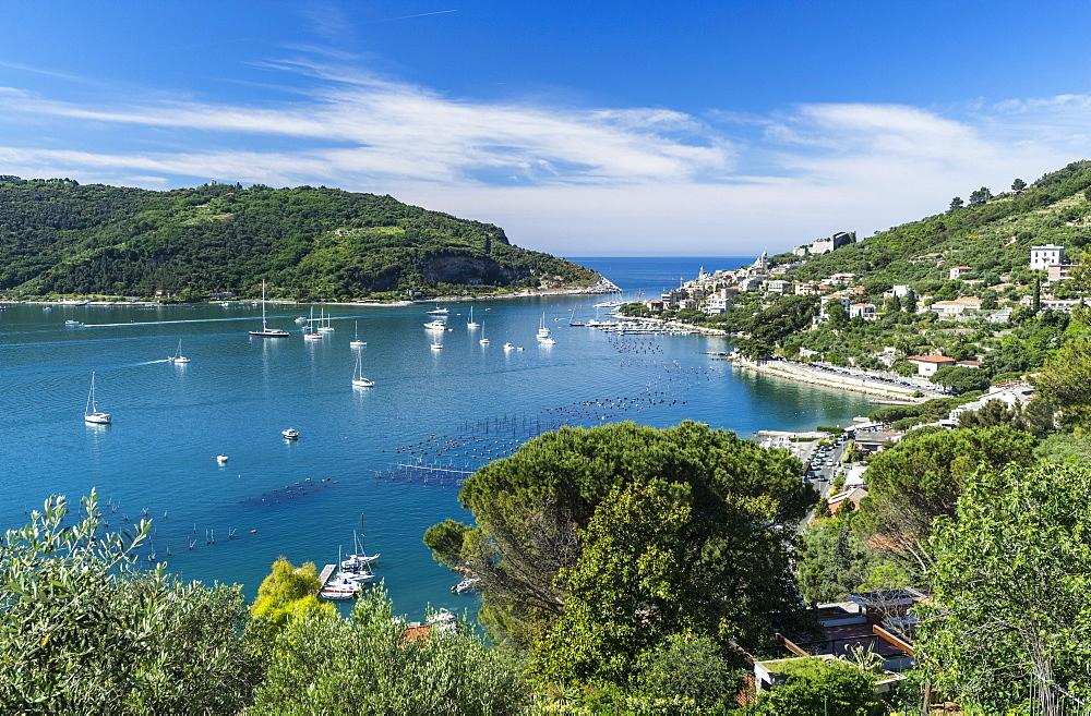 Green vegetation frames the turquoise sea of the Gulf of Poets surrounding Portovenere La Spezia province Liguria Italy Europe