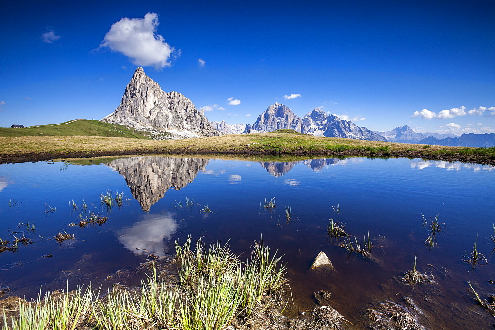 The Gusela peak and the Tofane Group by Cortina D'Ampezzo reflecting in the lake by Passo Giau, Veneto, Italy, Europe