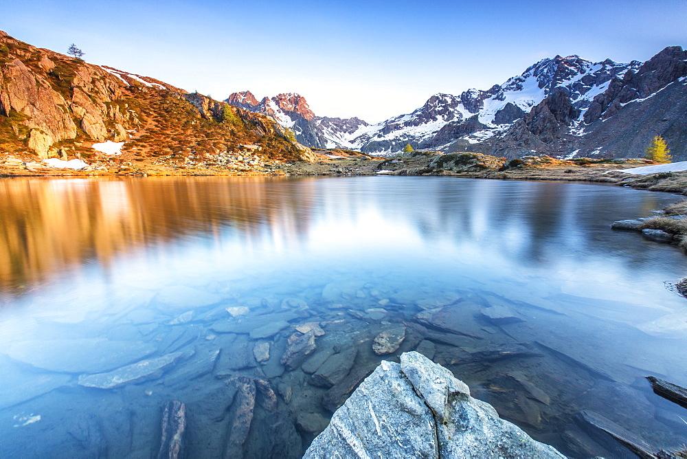 Snowy peaks reflected in Lake Zana at sunrise, Malenco Valley, Valtellina, Province of Sondrio, Lombardy, Italy, Europe