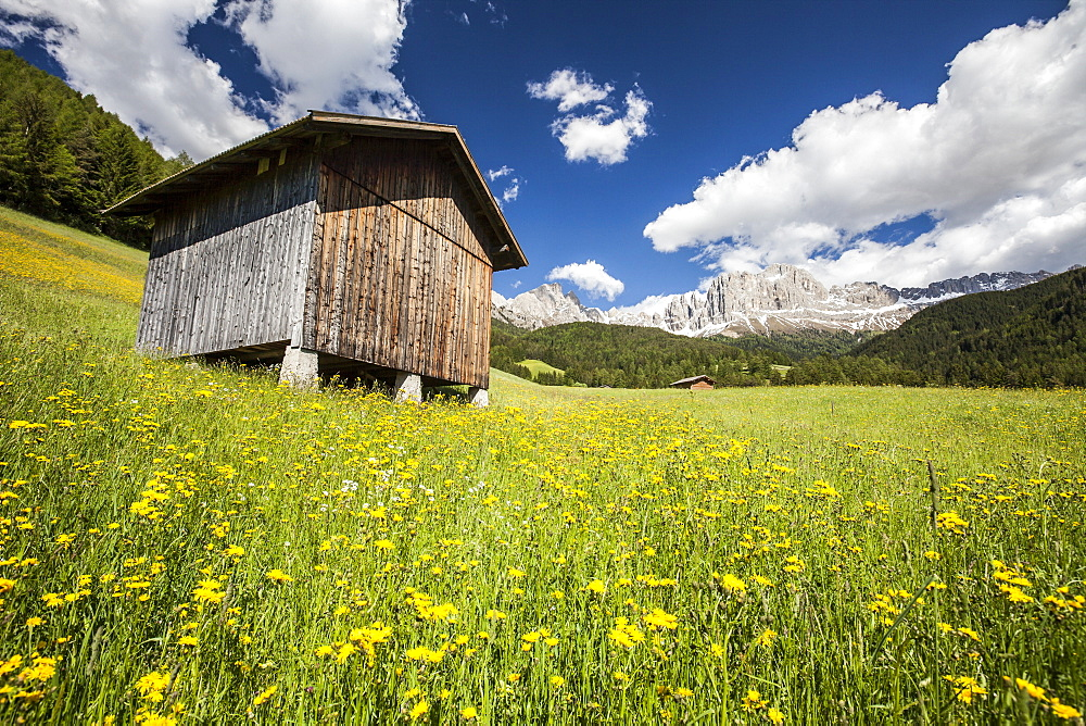 A typical mountain hut in the Tires Valley, by the Catinaccio Group and Lake Carezza in the Dolomites, South Tyrol, Italy, Europe