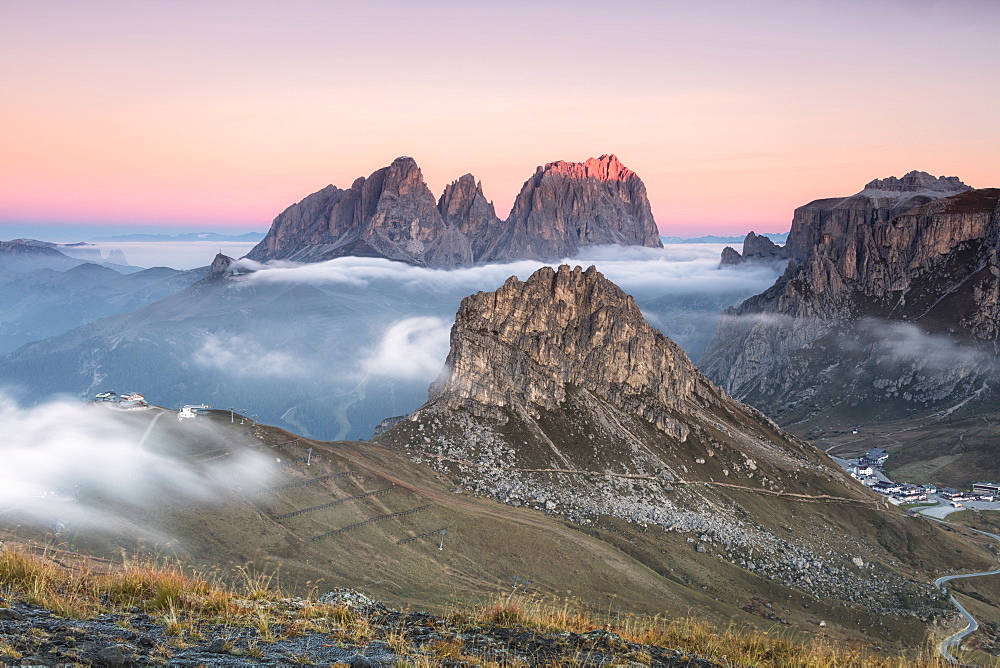Pink sky and mist on Sass Becè and Sassolungo seen from Cima Belvedere Canazei Val di Fassa Trentino Alto Adige Italy Europe
