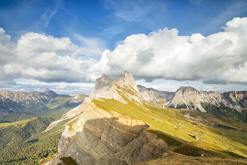 Blue sky and clouds on the rocky peaks of the Odle mountain range seen from Seceda Val Gardena Trentino Alto Adige Italy Europe