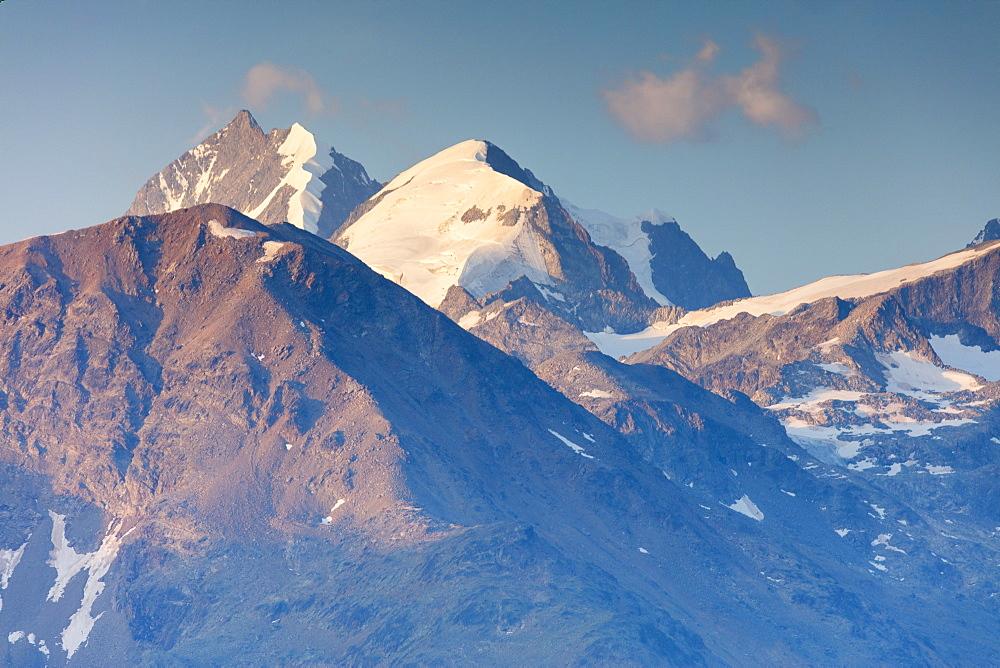 The high peaks partially covered with snow Muottas Muragl Samedan Canton of Graubünden Engadine Switzerland Europe