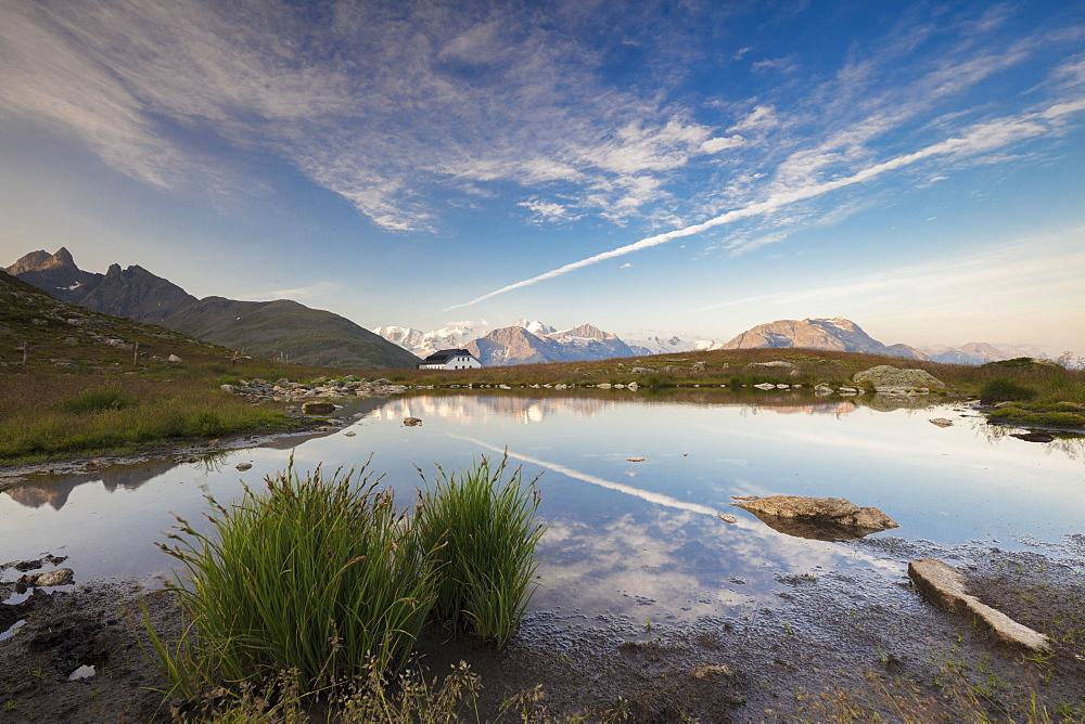 The clear sky is reflected in the blue alpine lake Muottas Muragl Samedan Canton of Graubünden Engadine Switzerland Europe