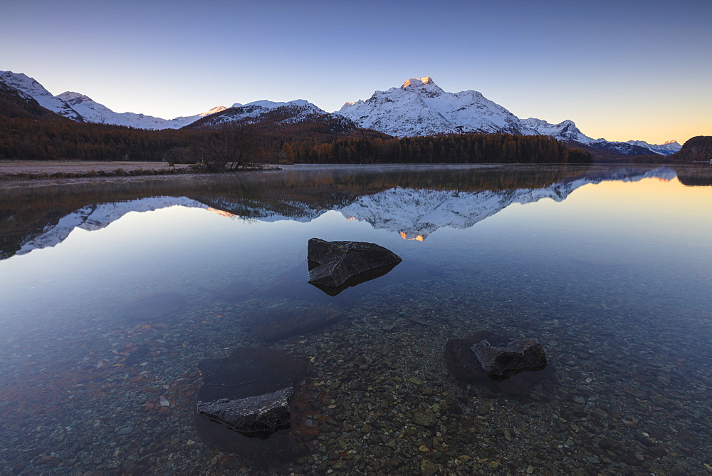 The snowy peaks are reflected in Lake Champfer at sunrise, St. Moritz, Canton of Graubunden, Engadine, Switzerland, Europe - 1179-1672