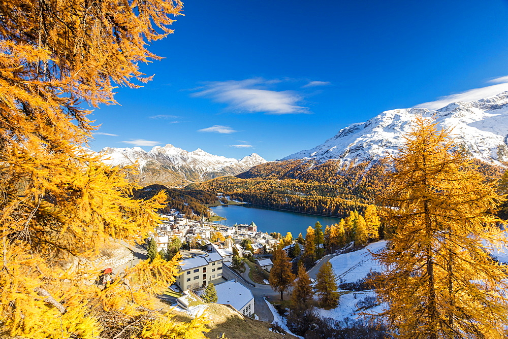 The alpine village of St. Moritz framed by colorful woods and the blue lake, Canton of Graubunden, Engadine, Switzerland, Europe - 1179-1680