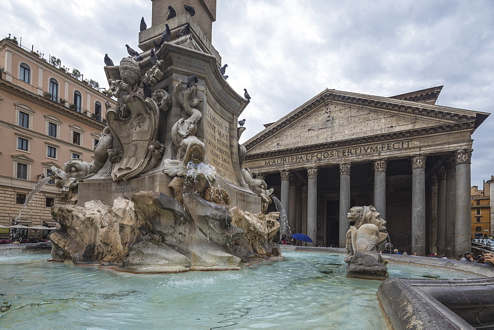 The fountain with statues frames the ancient temple of Pantheon Rome Lazio Italy Europe