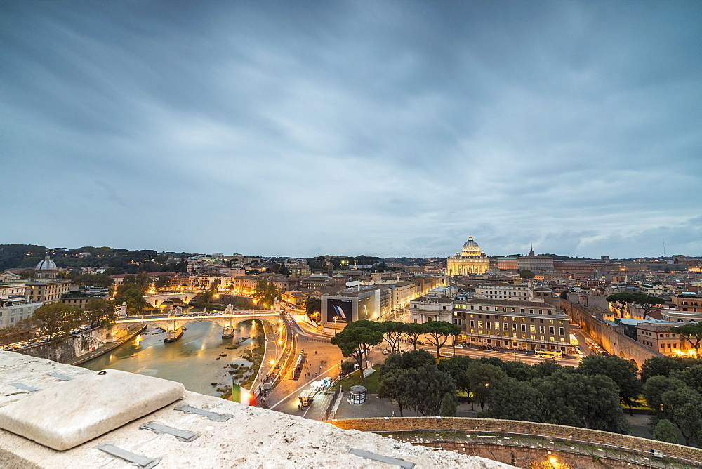 Dusk lights on Lungo Tevere with the Basilica di San Pietro in the background Rome Lazio Italy Europe