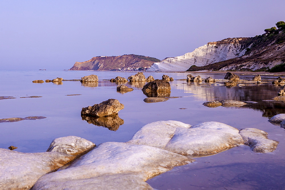 White cliffs known as Scala dei Turchi frame the calm sea at dawn, Porto Empedocle, Province of Agrigento, Sicily, Italy, Mediterranean, Europe