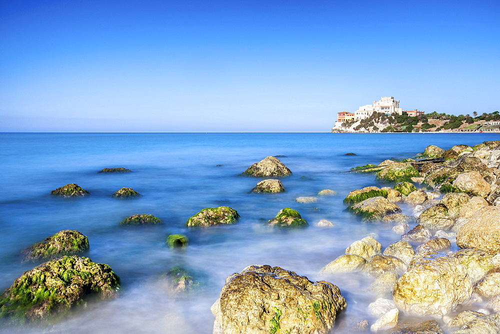 Sunrise on turquoise sea frames the medieval Falconara Castle Butera province of Caltanissetta Sicily Italy Europe