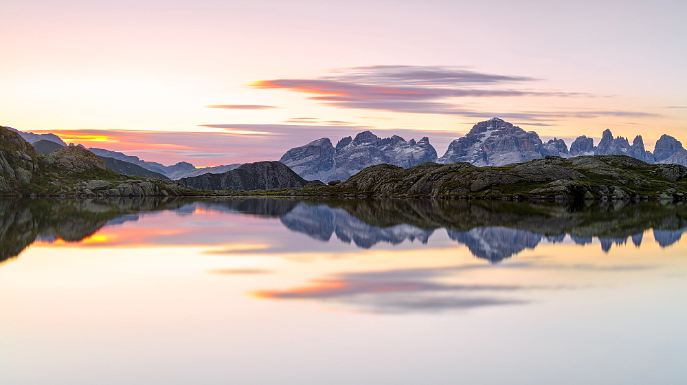 Pink clouds are reflected in Lago Nero at dawn, Cornisello Pinzolo, Brenta Dolomites, Trentino-Alto Adige, Italy, Europe