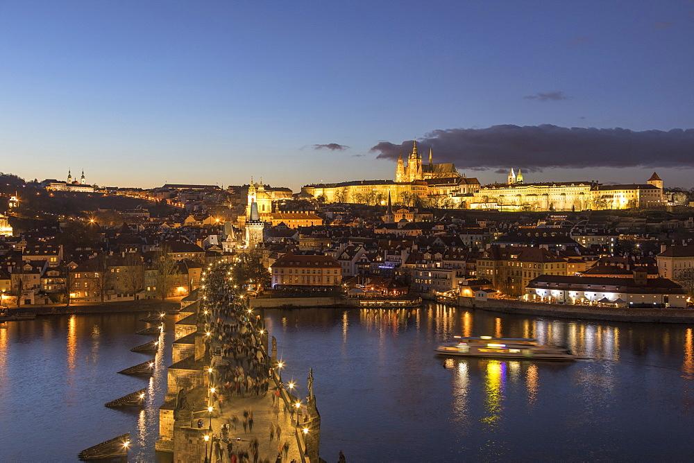Vltava River and Charles Bridge at dusk, UNESCO World Heritage Site, Prague, Czech Republic, Europe