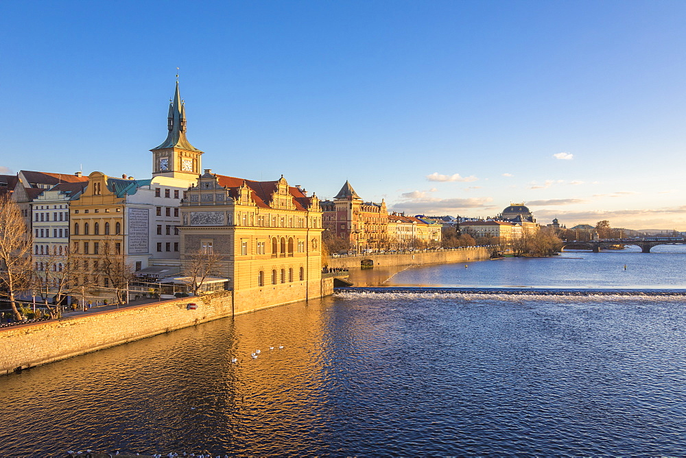 View of the Vltava River framed by historical buildings and bridges, Prague, Czech Republic, Europe