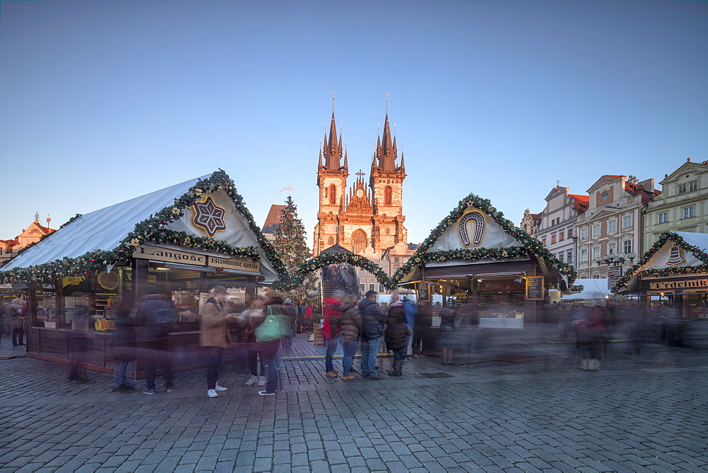 Tourists at the Christmas markets facing the Cathedral of St. Vitus, Old Town Square, Prague, Czech Republic, Europe