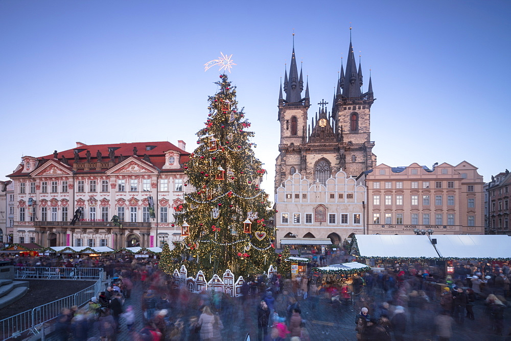 Tourists at the Christmas markets facing the Cathedral of St. Vitus, Old Town Square, UNESCO World Heritage Site, Prague, Czech Republic, Europe