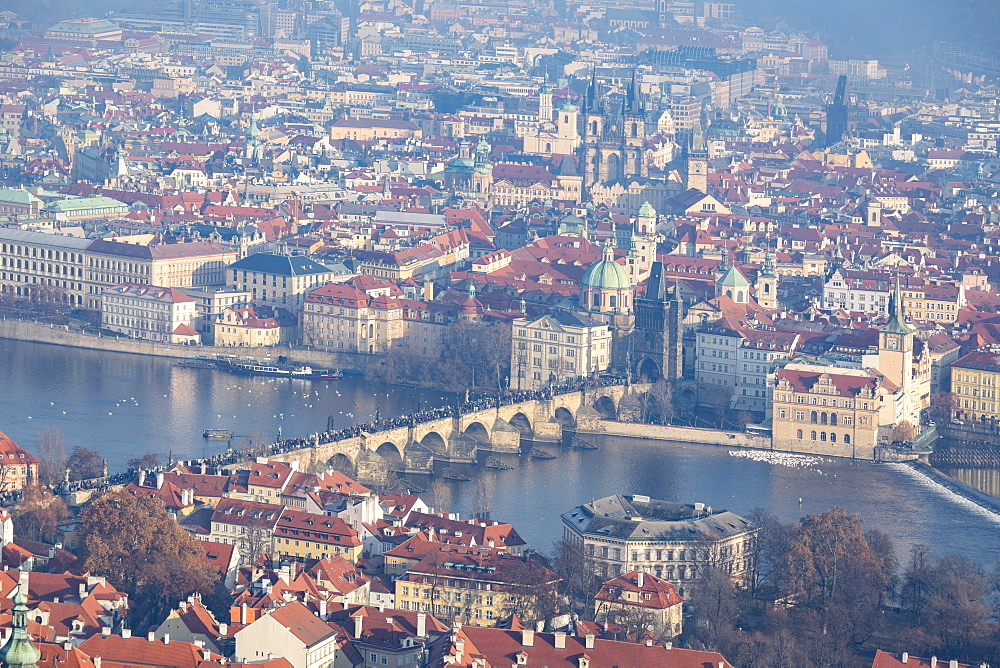 View of typical buildings and ancient churches framed by the River Vltava, Prague, Czech Republic, Europe