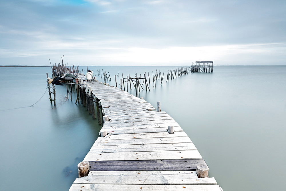 Soft lights of dawn on the Palafito Pier Carrasqueira Natural Reserve of Sado River Alcacer do Sal Setubal Portugal Europe