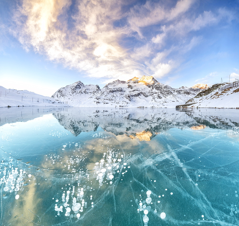 Panorama of ice bubbles and frozen surface of Lago Bianco at dawn, Bernina Pass, canton of Graubunden, Engadine, Switzerland, Europe