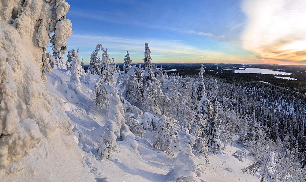 Panorama of snowy landscape and woods framed by blue sky and sun, Ruka, Kuusamo, Ostrobothnia region, Lapland, Finland, Europe