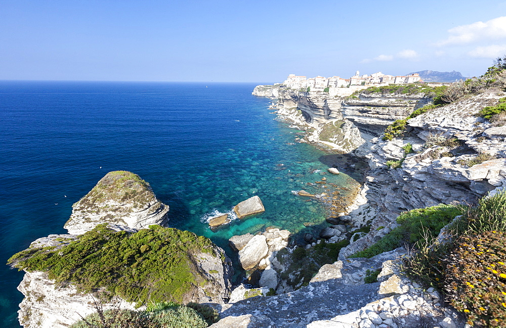 Turquoise sea frames the medieval old town and fortress perched on top of cliffs, Bonifacio, Corsica, France, Mediterranean, Europe