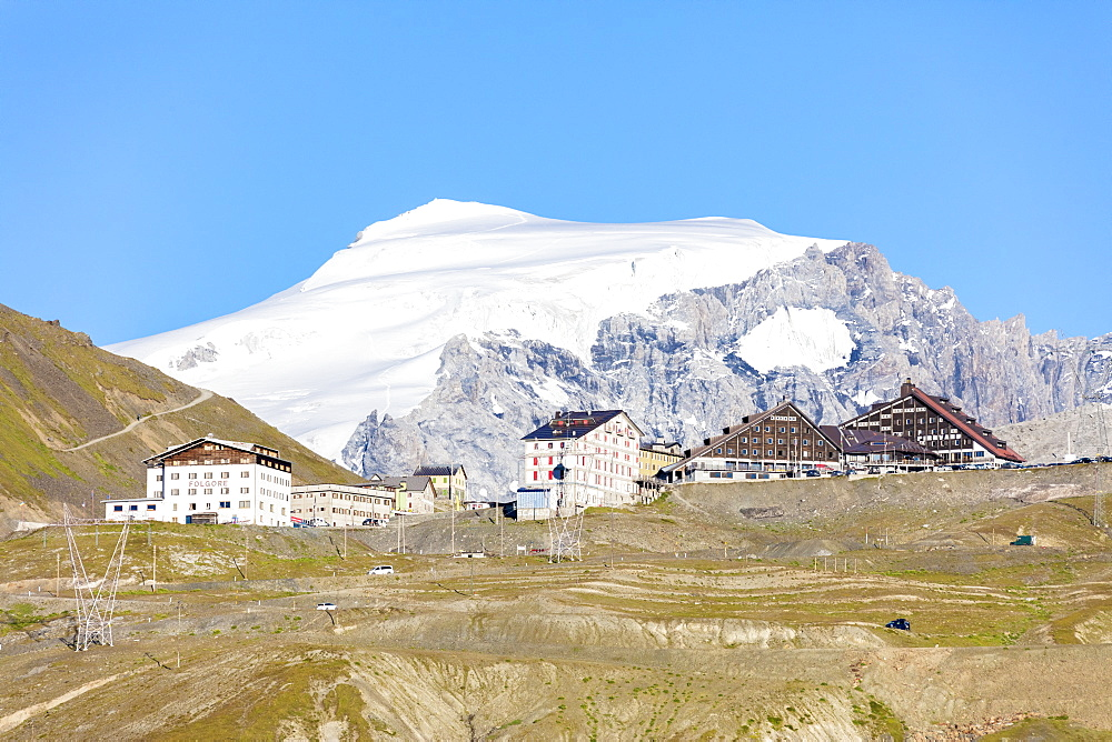 Blue sky frames the snowy peak of Mount Ortles at Stelvio Pass, Valtellina, Lombardy, Italy, Europe