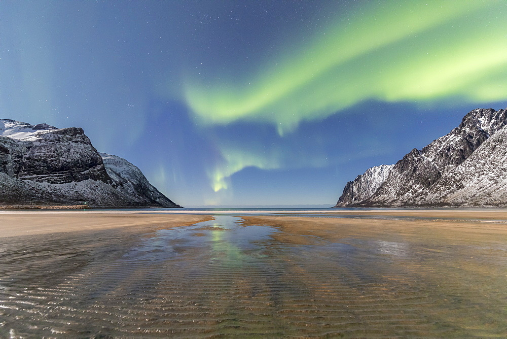 Sandy beach and snowy peaks framed by the Northern Lights in the polar night Ersfjord Senja Tromsø Norway Europe