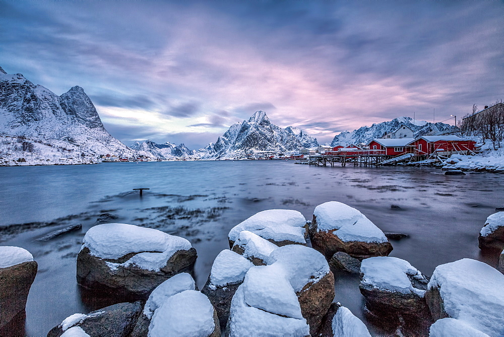 Picturesque sunrise in the Bay of Reine with the typical Norwegian rorbu, once home for the fisherman, now tourist accommodation, Lofoten Islands, Arctic, Norway, Scandinavia, Europe