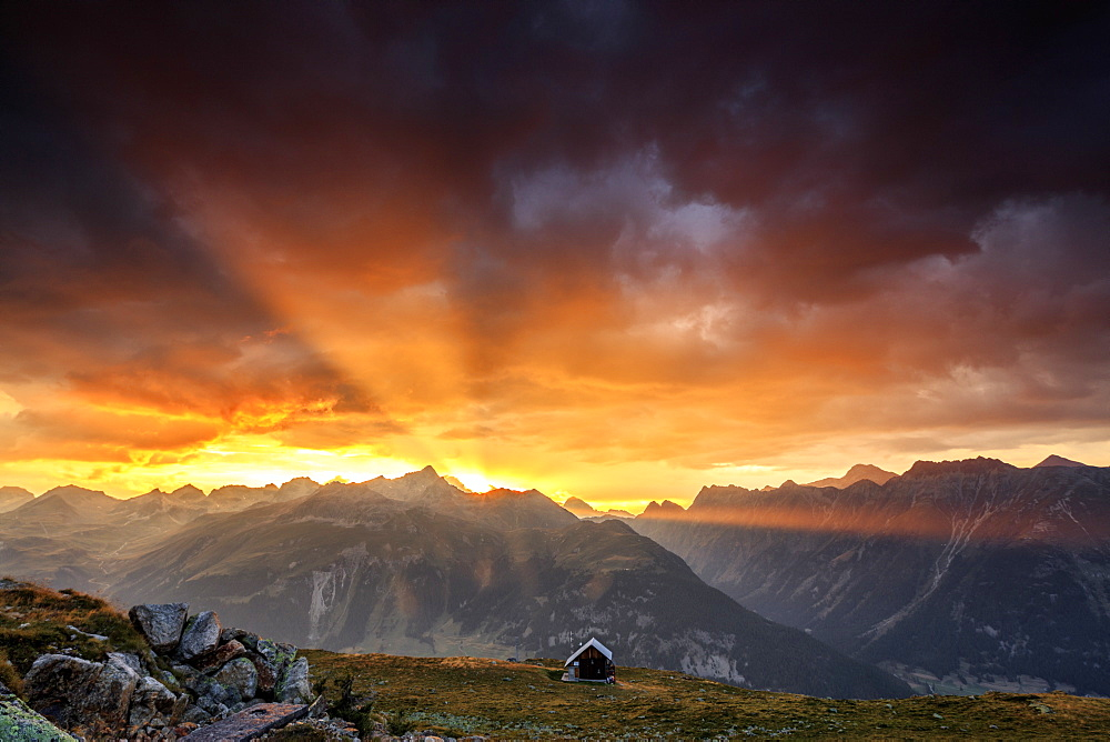 Rays of sun of fiery sky at sunset above the peaks, Muottas Muragl, St. Moritz, Canton of Graubunden, Engadine, Switzerland, Europe