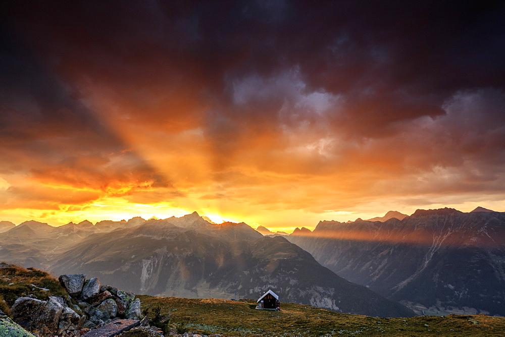 Rays of sun of fiery sky at sunset frame the peaks Muottas Muragl St.Moritz Engadine Canton of Graubünden Switzerland Europe - 1179-2086