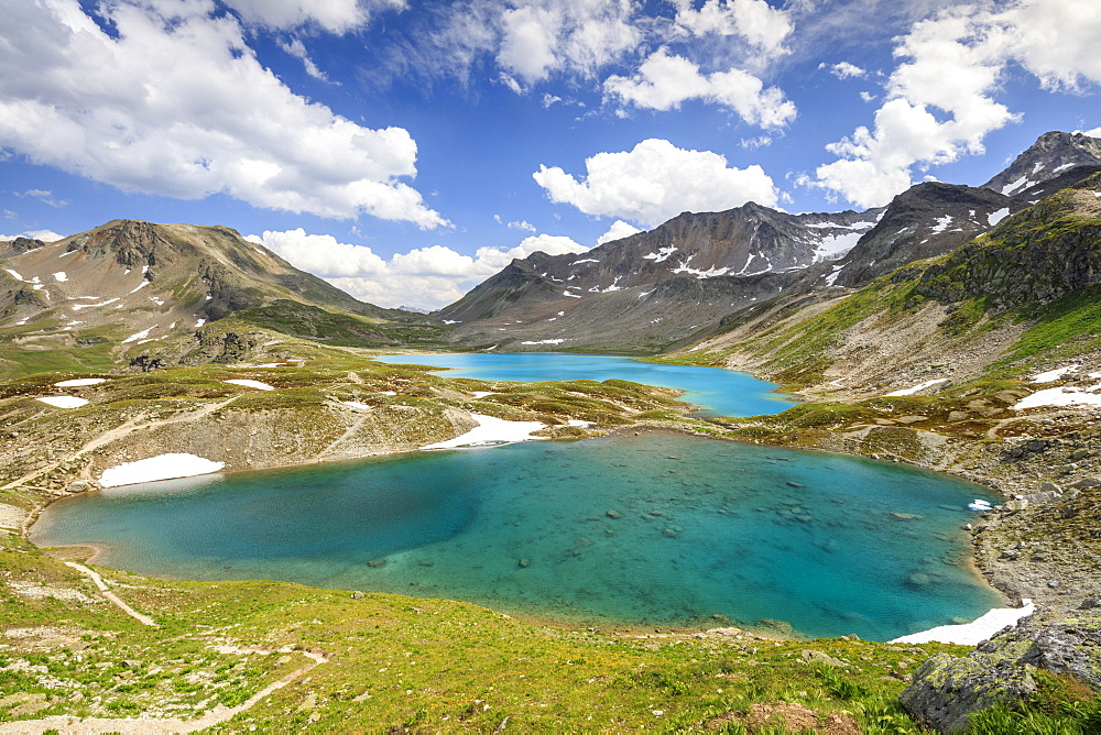 Clouds and sun on turquoise lakes framed by rocky peaks, Joriseen, Jorifless Pass, canton of Graubunden, Engadine, Switzerland, Europe