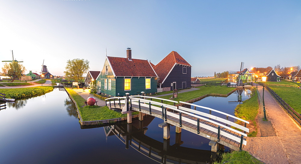 Panorama of wooden houses and windmills of the typical village of Zaanse Schans at dusk, North Holland, The Netherlands, Europe