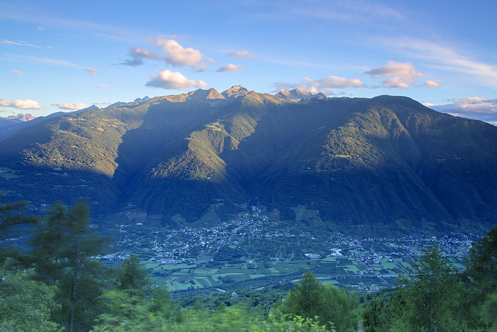 Top view of the village of Bianzone framed by the rocky peaks of the Rhaetian Alps at dawn, Valtellina, Lombardy, Italy, Europe
