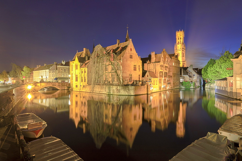 The medieval City Centre, UNESCO World Heritage Site, framed by Rozenhoedkaai canal at night, Bruges, West Flanders, Belgium, Europe