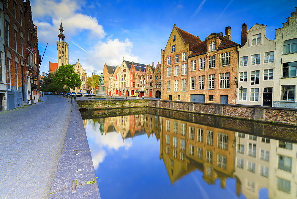 Bright sky at dawn on historic buildings and houses of city centre reflected in the canal Bruges West Flanders Belgium Europe