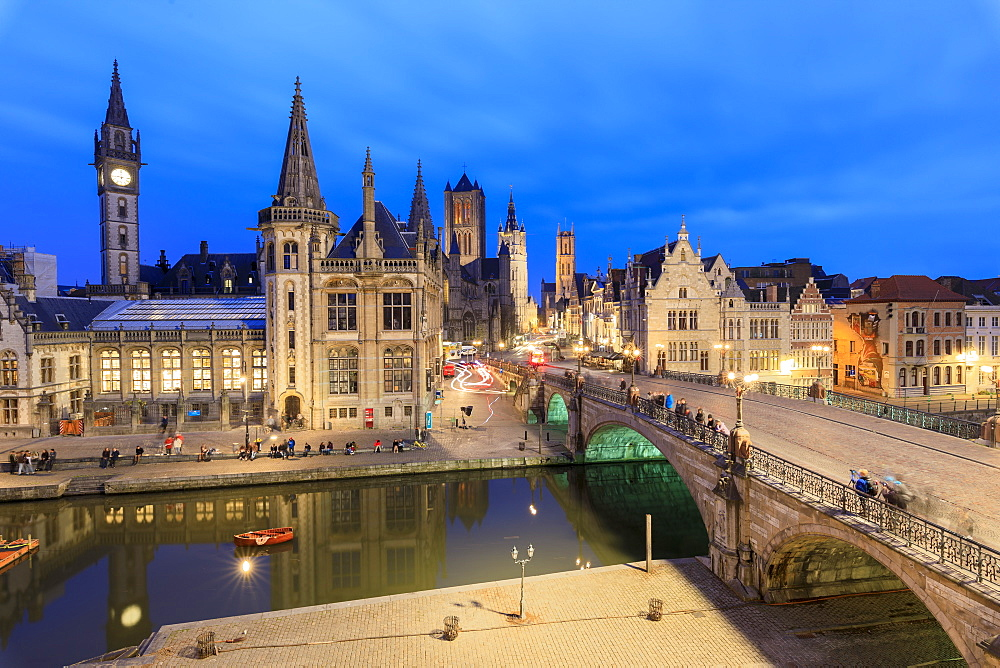View of the historic area of Graslei and bell tower along Leie river at dusk, Ghent, Flemish Region, East Flanders, Belgium, Europe