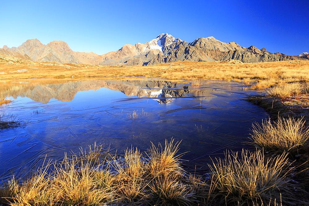 Blue lake frames the peaks of Mount Disgrazia and Cornibruciati, Val Torreggio, Malenco Valley, Valtellina, Lombardy, Italy, Europe - 1179-2234