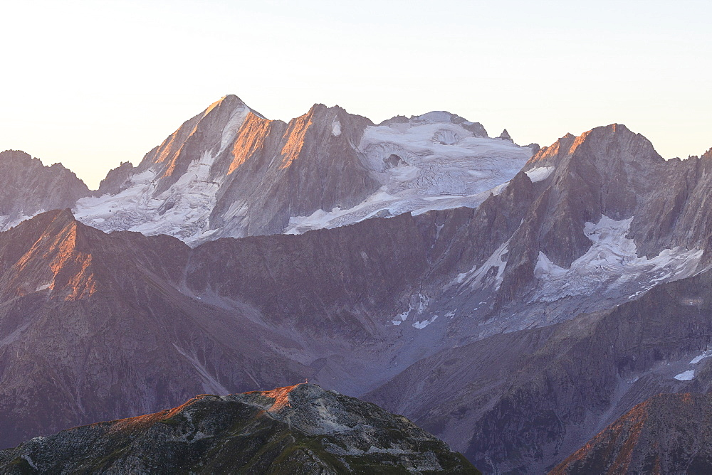 Rocky peak of Cima Presanella seen from Monte Tonale at dawn, Valcamonica, border Lombardy and Trentino-Alto Adige, Italy, Europe