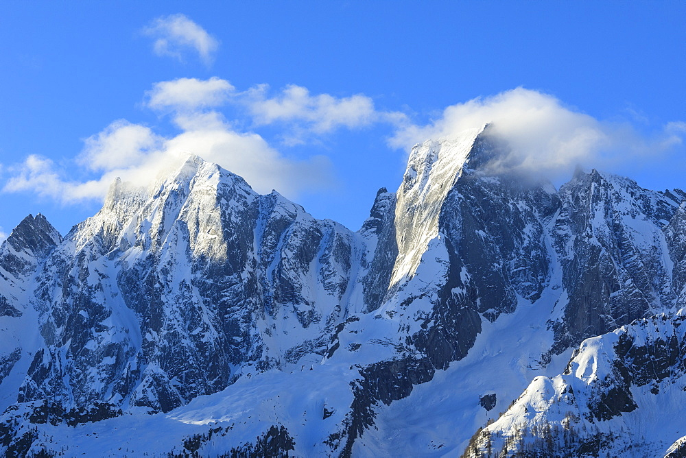 Rocky peaks Badile and Cengalo covered with snow in spring Soglio Bregaglia Valley canton of Graubünden Switzerland Europe