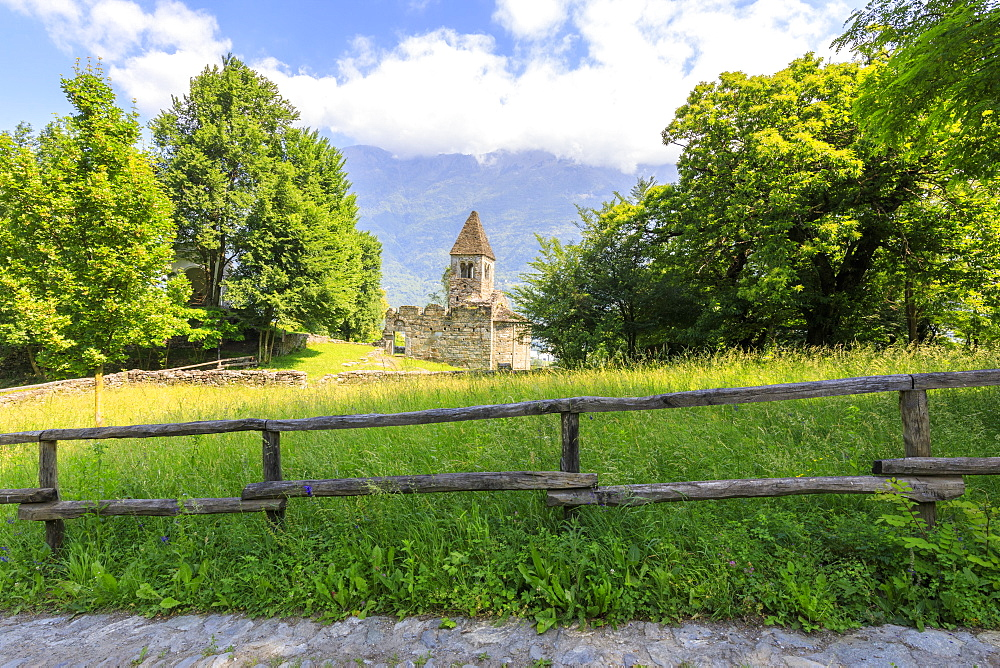 The medieval Abbey of San Pietro in Vallate framed by meadows Piagno Sondrio province Lower Valtellina Lombardy Italy Europe - 1179-2310